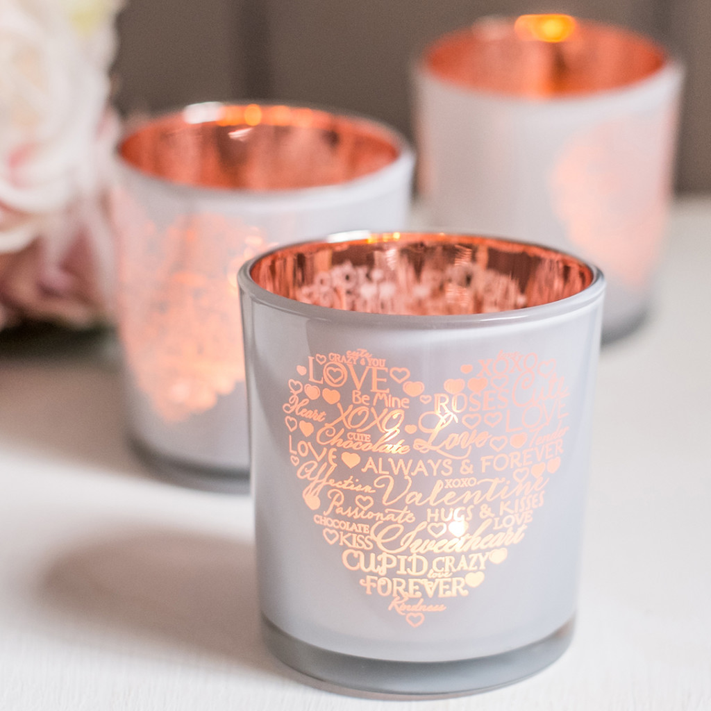 three white and rose pink tea lights for a NITHS commercial product shoot